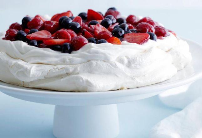 Berry Pavlova dessert white red blue