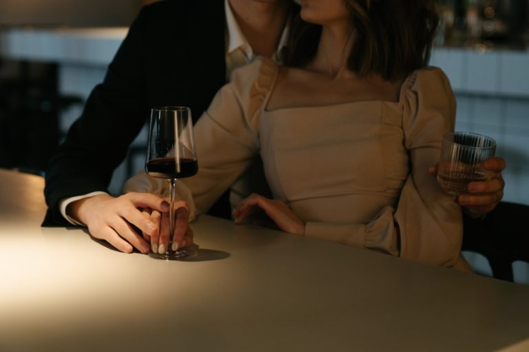sexy couple at bar wine glasses love dating